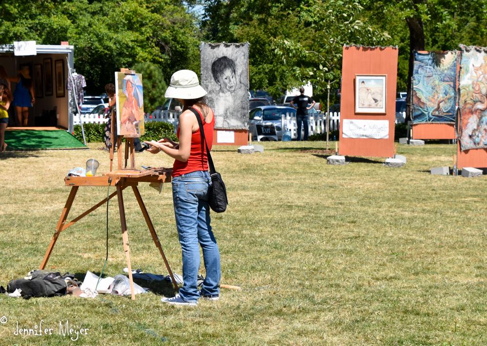 An artist paints on the spot.