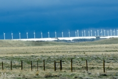 Windmills in a dark sy.