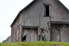 An old barn by the road.