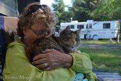Kate loving her cat.