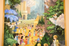The main painting shows children arriving in heaven.