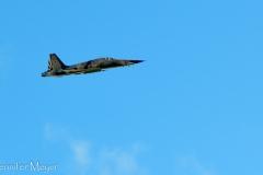 Fight jet roaring above.