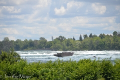 An ominous shipwreck in the river above the falls.