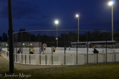 There was a field hockey rink in the park.