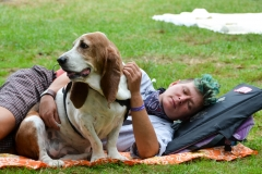 Festival goer rests with her pal.