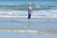 Fisherman and bird.
