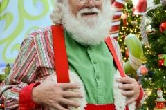 Santa pauses before taking his seat.