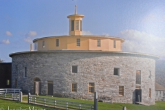 Photo of a round barn in another vilage. Shakers invented the round barn.