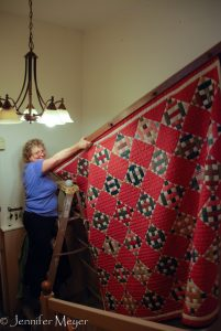 Down comes Kate's grandma's quilt.